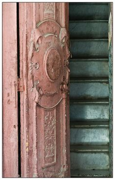 Old Pink Chippy...door & turquoise steps.