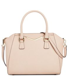 At brunch or in the boardroom, this Calvin Klein satchel makes a fashion statement in solid Saffiano leather with an easy removable shoulder strap. | Imported | Saffiano leather | Double handles with