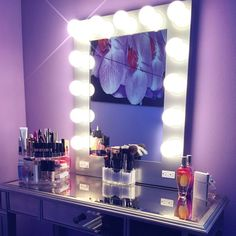 How soothing is this orchid inspired vanity room by @jackievidal #vanitygirloftheday. I love the lavender walls and mirrored table that seems to under light everything ontop of it. Mirror: #silverbroadway from VanityGirlHollywood.com $399