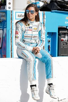 Danica Patrick driver of the Nature's Bakery Chevrolet sits on the pit wall during qualifying for the NASCAR Sprint Cup Series New Hampshire 301 at...