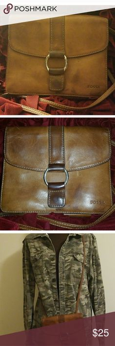 Fossil Vintage Leather Crossbody Purse Vintage brown Fossil leather crossbody. Timeless  piece featuring a large outside zipper pocket on the back, two interior compartments, cellphone slot, and zipper pocket.  Button closure. Fossil lettering on the front. Leather is worn and has a few markings on it, including on the corners  as photographed.Silver outside buckle is tarnished. Tons of life left as Fossil leather bags never go out of style, and have markings that add character to the…