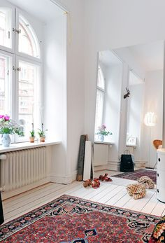Love this white room with oriental rug, which I'm shopping for now. I wouldn't mind living in this open loft either.