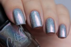 Edith - Intense silver linear holo with very light blue to lavender undertones and golden pink shimmer.  This polish takes on different colors in different light.  It can cast light blue, pink, lavender, and several other colors depending upon the lighting. Swatch by @de_briz on IG in daylight.
