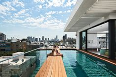 Six stories high, crowned with a pool, and with a direct lineage back to the Bauhaus, a new town house in Tel Aviv manages to both embrace and provide refuge from the teeming Israeli city. Photo by Amit Geron.