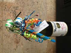 How adorable is this neighbor gift for New Year's eve?  Celebration packaged up-sparkling cider with party blowers. Perfect to give after the Christmas rush is over.