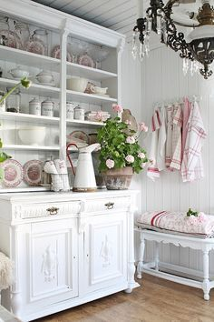 French country decor in shades of red and white.