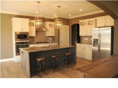 This is the look I want in my kitchen.  Cabinets, colors, and all.