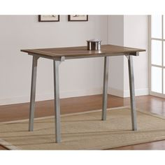 @Overstock.com - Tabouret Metal and Wood Table - The tabletop of this chic tabouret metal and wood furniture features a weathered grey oak finish with a durable scratch-resistant silvertone power coat finish on the legs and frame. It adds a unique new style to any corner of your home.  http://www.overstock.com/Home-Garden/Tabouret-Metal-and-Wood-Table/6713417/product.html?CID=214117 $249.99