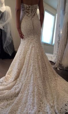 Cannes giupure lace wedding dress with taffeta underlay, deep sweetheart neckline and sheer lace back, featuring a subtle sweep train. This dress is a show stopper and perfect for any type of wedding.