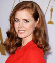 Amy Adams gave her auburn strands extra dimension by adding loose, touchable curls. - Steve Granitz/WireImage