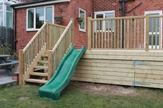 Raised decking with Childrens slide play area completed in ...