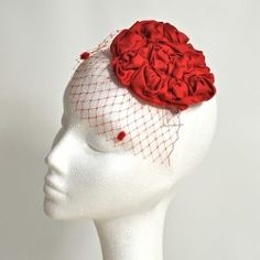 Small red fascinator