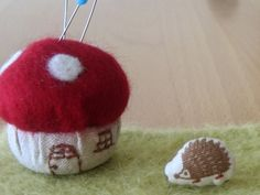 Bottle cap pin cushion, and oh the little hedgehog!