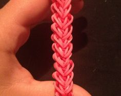 """See Suzanne Peterson's You Tube video for the """"HEART"""" bracelet at http://www.youtube.com/watch?v=iUr8f4TsBhE This is similar to the Learning Express Valentine Heart bracelet but not the same. This is also not Lesson 12: on the Rainbow Loom site as originally posted."""