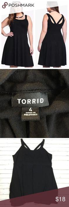 "Torrid black strappy cutout back retro dress Torrid Women's retro strappy cut out back black solid dress. size 4x. some fuzzing to fabric  armpit to armpit-20.5"" overall length-38"" torrid Dresses Midi"