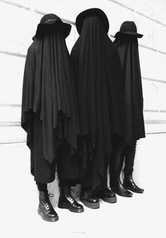 Black & White. Anonymous. Layers. Hats. Ghosts. Fashion. Art. Message. Boots. Model. Three. Modern.