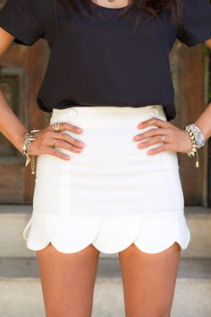 White skirt w/ black top, plus adorable jewelry.