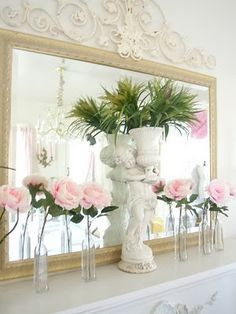 Simple but elegant-- the tropical plant has a conservatory feel among the roses.