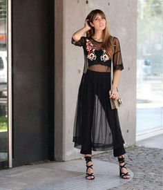 The black sheer dress works well with the black pants underneath period a very sophisticated, and tip look