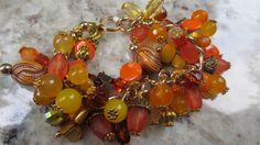 Ladies charm bracelet. Shades of fall are by Somethingissparkling, $50.00