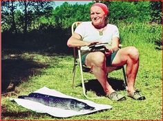 JPII fishing from Abbey-Roads...note the scapular around his neck