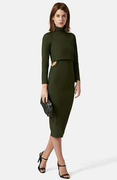 Free shipping and returns on Topshop Cutout Body-Con Midi Dress at Nordstrom.com. Subtle ribbing lends sublime texture to a long-sleeve body-con dress that features an overlay bodice topped with a turtleneck and a midi skirt with skin-flashing cutouts at the waistline.