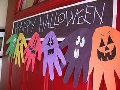 Halloween Hand Print Ghoul Banner | Crafts by Amanda.   My idea  for Christmas: turn hands up and make reindeer and Merry Christmas