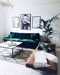 Elegant Swedish inspired living space with a green velvet sofa