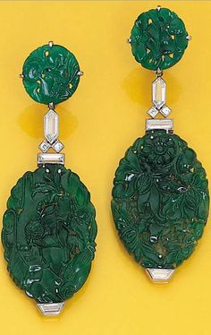 A PAIR OF JADEITE AND DIAMOND EAR-PENDANTS, BY CARTIER  Each designed as a carved jadeite panel to the bezel-set vari-cut diamond surmount suspended from a circular carved jadeite top, circa 1924 Signed by Cartier.