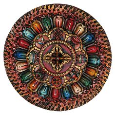 This intricately carved and painted wooden mandala is featured on the iTradeNepal site.     http://itradenepal.com/itradenepal/product/78.html
