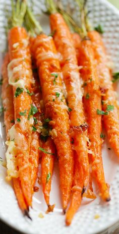 Garlic Parmesan Roasted Carrots - Oven roasted carrots with butter, garlic and Parmesan cheese. So easy and delicious!