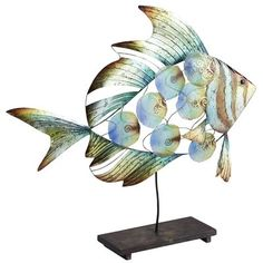 Adding an aquatic theme to our collection of sculpted art made with natural capiz, this fish casts a mesmerizing spell. The hand-painted finish, in shades of turquoise, blue, bronze and gold, catches the light just right. One look, and you'll be hooked.