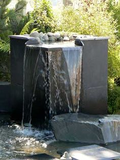 No garden fountain can be turned into absolutely childproof, but there are lots of ways that you can make yours safer. A garden water fountain is a simple approach to beautify your lawn. Best Fountains for Entryways If you do… Continue Reading → Modern Water Feature, Outdoor Water Features, Backyard Water Feature, Water Features In The Garden, Garden Water Fountains, Water Garden, Wall Fountains, Garden Pond, Garden Plants