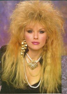 Nancy Wilson of HEART.  hahaaha...and we thought the hair was sooo coool!! LOL  Aqua Net anyone??  LOL