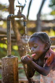 Hey Nestle! WATER IS A HUMAN RIGHT! A RIGHT OF ALL LIVING THINGS! pictured, 3-year-old Ronester takes a drink of #cleanwater from the faucet next to her grandparents' home. #WorldVision installed the tap using a solar-powered mechanized borehole, all fueled by donations from our generous donors and now, Ronester will never have to know what it's like to walk long distances for clean water! #ShareBigDreams #Zambia #GiftCatalog (Photo: 2016 World Vision/photo by Jon Warren)