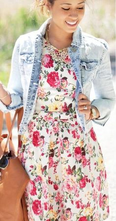 This combo of a light blue denim jacket and white floral fit and flare dress…