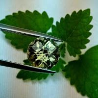 Naturally Precious: Phenomenal color-change Zultanite® Checkerboard Cut Gemstone: www.Zultanite.Org