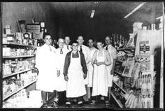 Country Store [Grocery], Richardson, Texas : The Portal to Texas History.Written on back: Fred Winkler, Morgan Gant, Billy Giles, James Tune, Clarence Hastedt and Tillman Jones. 1953. (2 youths, Ronny Clark and Jackie Fielder, standing in front) all wearing aprons.