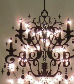 DIY: Make a painted canvas wall Chandelier, that truly gives off light. This would look gorgeous above the headboard!