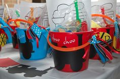 Train favors - fill the buckets with a whistle, hat and bandana plus a cookie to take home for each child.  I will do the trains on the buckets with chalkboard vinyl on my cricut and put each child's name on the bucket.
