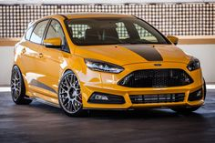 We at FSWERKS have enjoyed working with Ford transforming the 2015 Ford Focus ST into a balanced performance machine with a clean style that grabs your attentio Ford Focus Sedan, Ford Focus Hatchback, Car Ford, Ford Gt, Ford Mustang, Mustang Cars, Ford Trucks, Ford 2015, Sema 2015