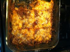 Low Carb Cheesy Enchilada. I like to make enchiladas with low carb tortillas and cheeses and green onions, olives. I'm not sure what's in her recipe.