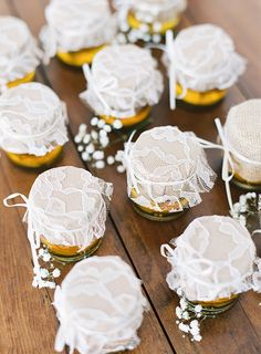 honey jars decorated with lace and fine ribbon *     {snippet and ink -- classic wedding with baby's breath and toile, photography by adam barnes}