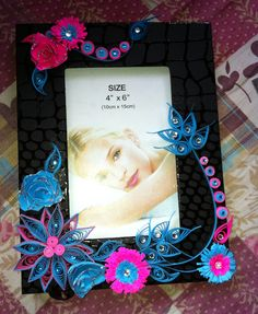 Quilling on photo frame by me