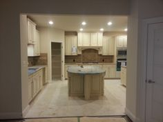 Here is our Kitchen during the construction of our home. Cabinets are Timberlake Sierra Vista with Hazelnut Glaze as the color, with Giallo Ornamental as the granite.
