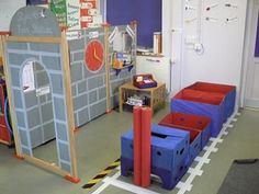 he train station was designed as part of a topic on travel called 'Lets Move'. The children go on imaginary journeys; they use time and money when making booking and buying tickets.
