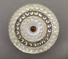 Pearl and metal button made in Birmingham between 1780 and 1820 collected by James Luckcock.