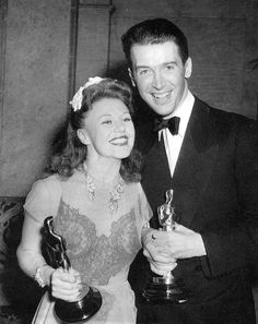 """Jimmy Stewart and Ginger Rogers mug for the cameras as they hold their Oscars for """"The Philadelphia Story"""" and """"Kitty Foyle"""" respectively."""
