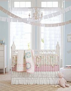 vintage inspired nursery with pink, blue, and green colors and a white ruffle skirt
