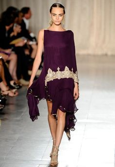 Britain's next top model Cara Delevingne stalks the spring/summer 2013 catwalks  Marchesa' s make-up team highlighted Cara's eyes in an inspired way, as she sashayed down the catwalk looking luminous in purple.